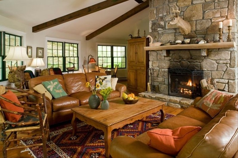 Lakehouse Great Room Features Massive Stone Fireplace and Beamed Ceiling