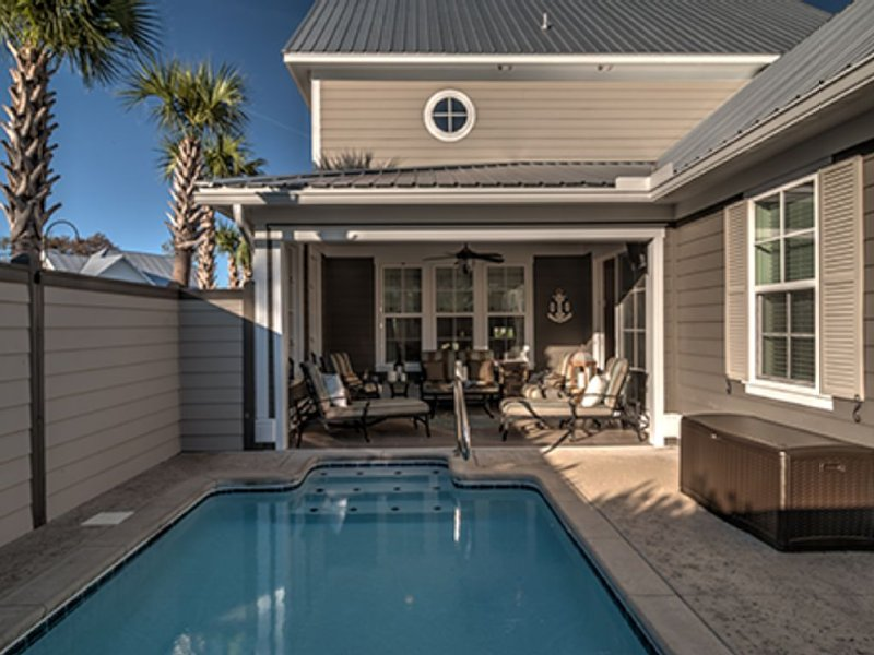 Relax with a private outdoor pool with covered patio