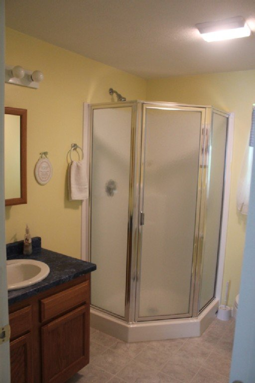 2nd bathroom is very spacious, with a sink, toilet, and large standup shower.
