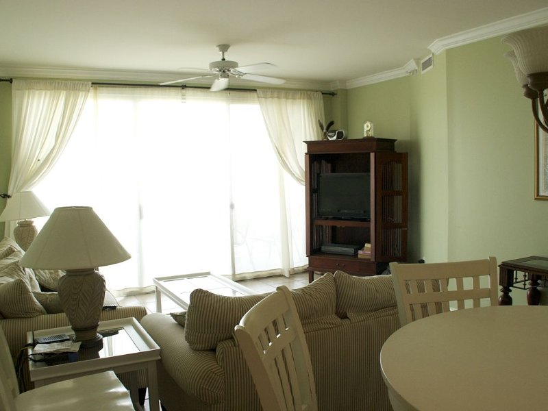 Living Room, Sliding glass door to balcony overlooking the beach.