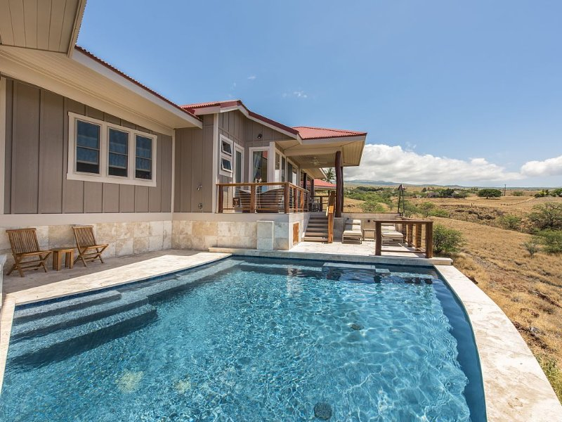 Star-gazing outdoor tub, pool deck and panoramic view of mountains and ocean.
