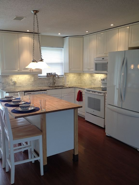 Kitchen remodeled with oven microwave and large refrigerator/freezer.