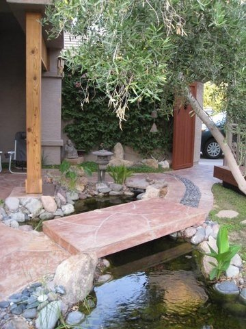 Courtyard entrance with koi pond, turtles, and waterfall