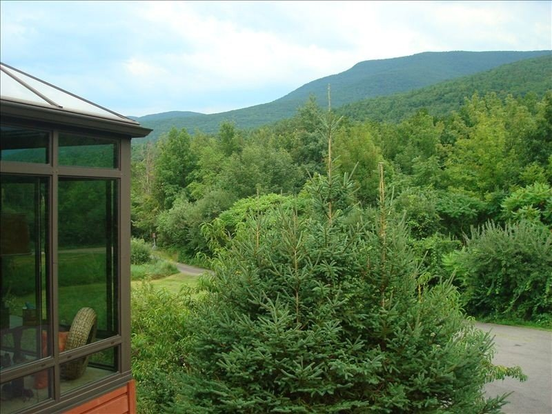Breathtaking views from the front porch, balcony and the four seasons room