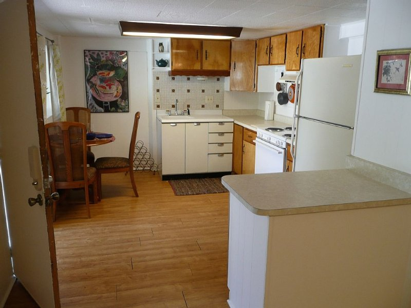Full kitchen with cooking and dining amenities