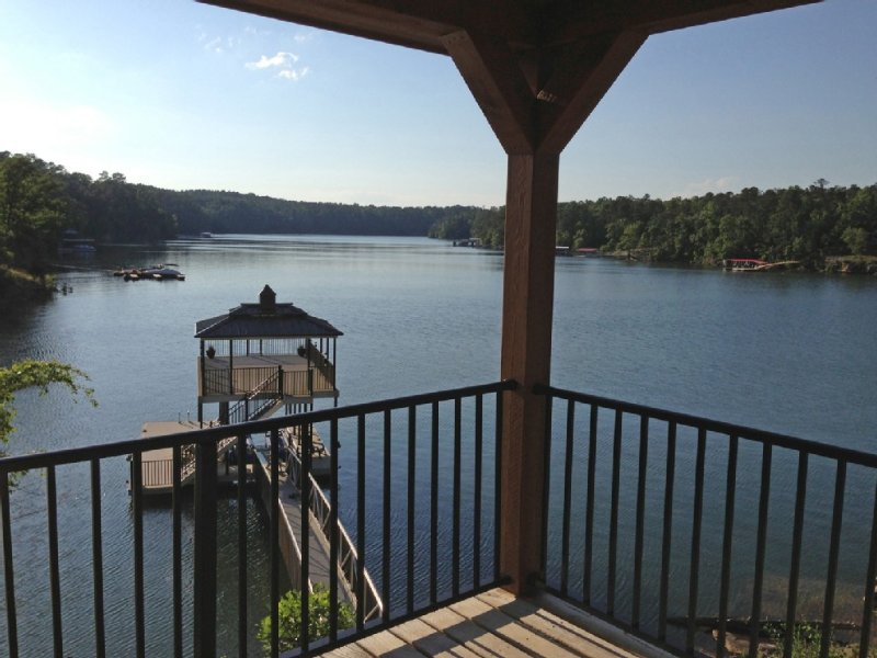 View looking left from deck toward new boathouse with swim pier and boat lift.