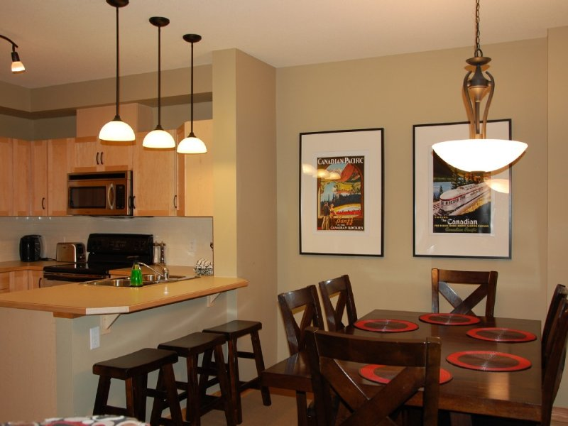 Dining room with 6 chairs and 3 bar stools