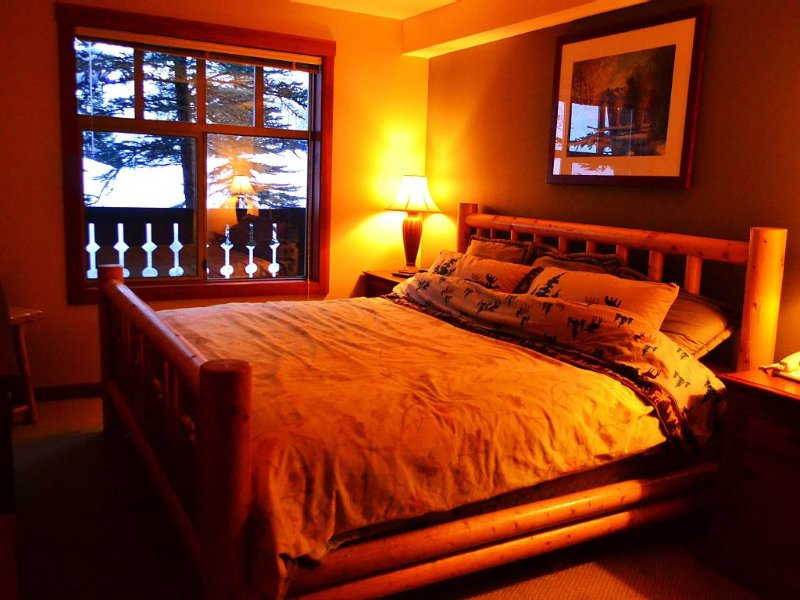 Master Bedroom with King size log bed.