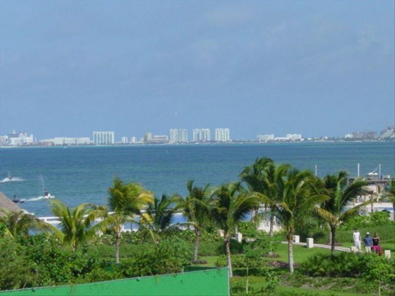 View of Garden, Pool, Caribbean, and Coastline Toward Hotel Zone from Balcony