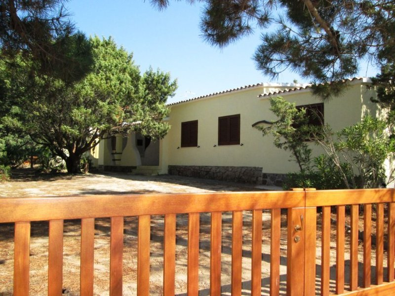 Gate and Porch in front of Double Villa, ample parking for cars or tour bicycles