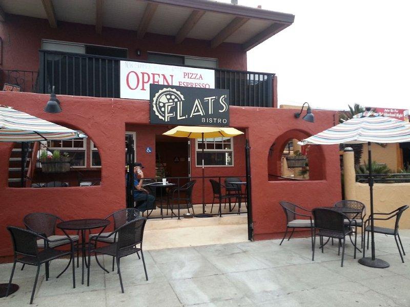 Flats Bistro at the beach - 2 min walk .  Open all day for espresso & pizza