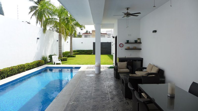 Private and heated 270 square feet pool,  terrace with dining and seating set.