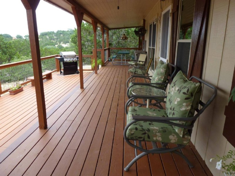 New cushions and ceiling fan on the covered deck.