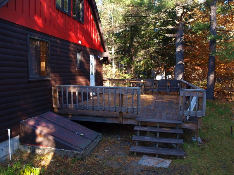 Large deck in the back of the cabin overlooking the back yard!
