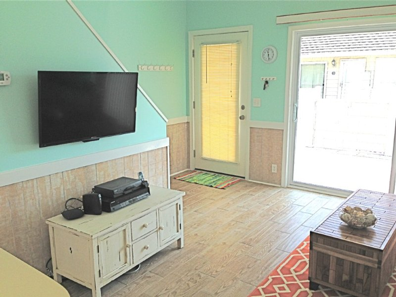 Flat screen tv with dvd/vcr and movie library.