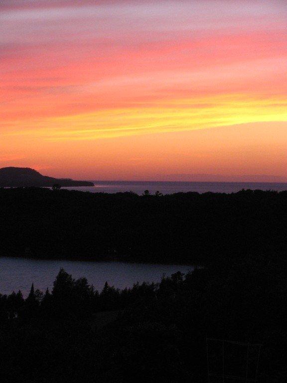 Amazing sunset views of Little Traverse Lake, Lake Michigan, & the Manitou Is