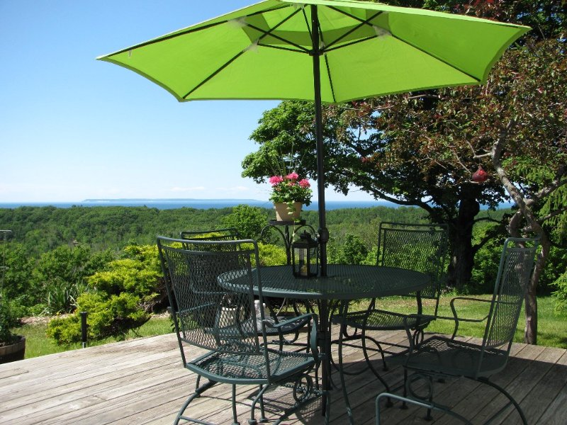 The large deck is great for alfresco dining and enjoying the amazing views.