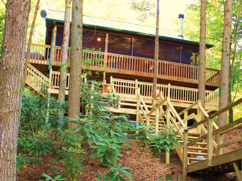 Rear of cabin with steps down to hot tub and overlook deck