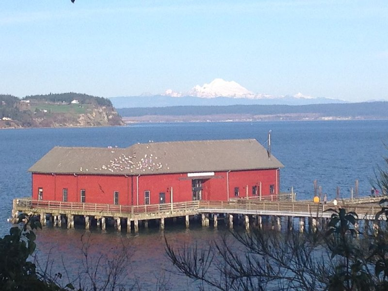 Historic wharf on dock in town with Mt Baker