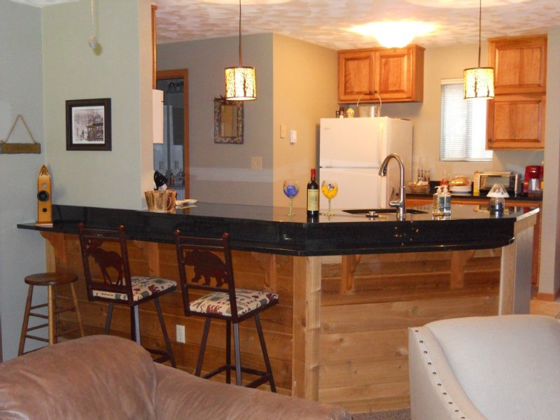 Bright open kitchen with granite countertops and ceramic tile floors.