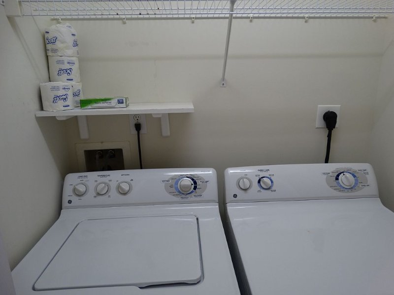 Full size washer and dryer located in the main hallway.
