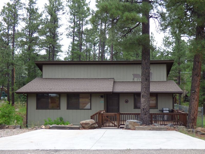 Front View with 3 Car Driveway and fenced deck