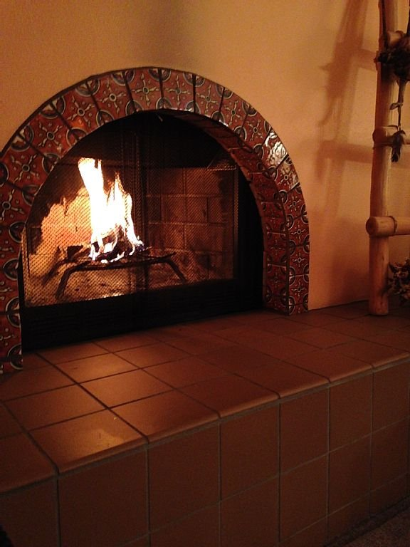 Kiva-style fireplace in living room