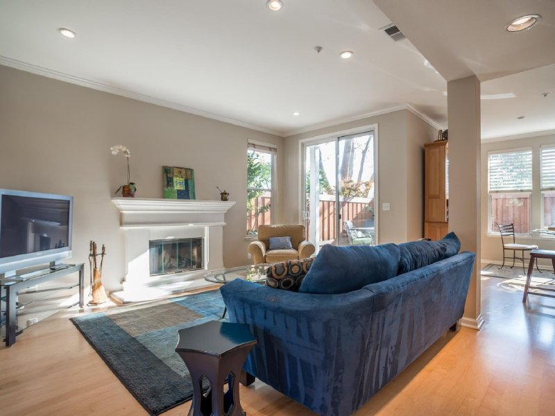 Well lit open concept downstairs with easy access to back patio