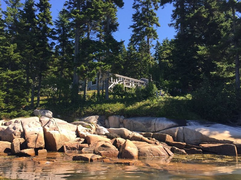 The cottage from the water at close-to high tide.