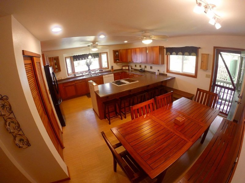 Large fully stocked kitchen & dining room area, more than enough room for 8.
