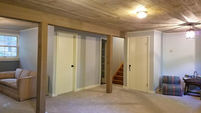 Open plan TV room and play room.