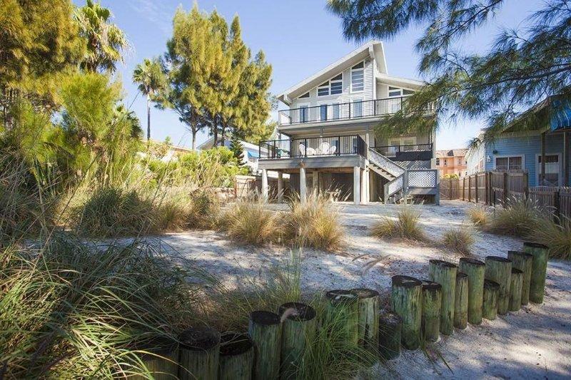 5 bedrooms 4.5 bath beachfront home on the white sandy Treasure Island beaches.