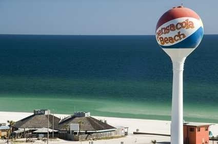 The Pensacola Beach water tower marks the central beach location and Gulf pier.