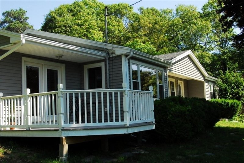 Front view of the house with a balcony.
