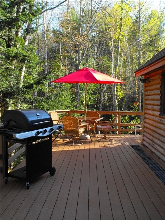 Deck of  Azure Teal Lodge with grill lounge sunning chair just around corner