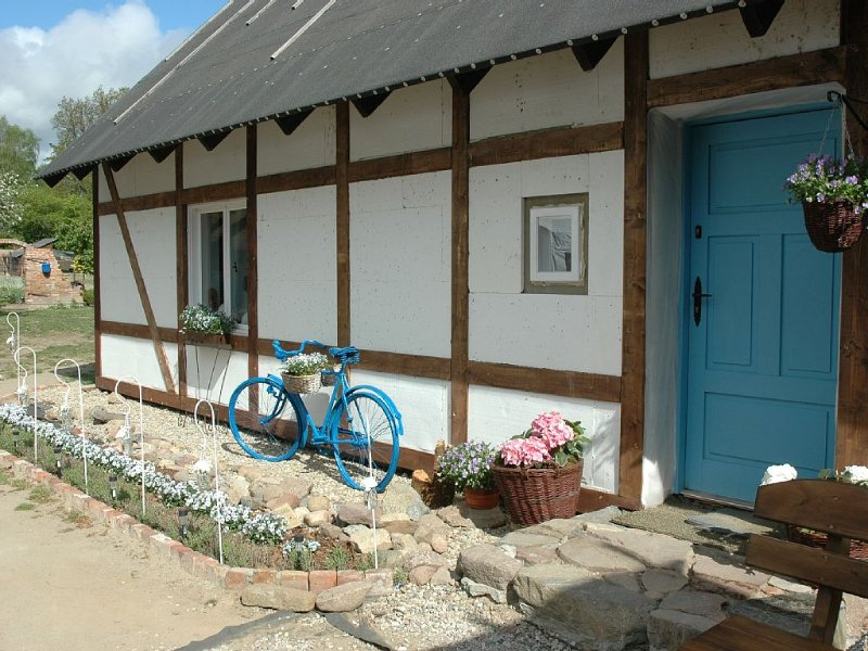 Front of house with old bicycle...