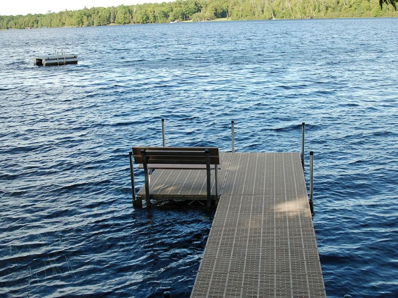 New pier awaits your boat, or use the 12' row boat on property; swim  raft