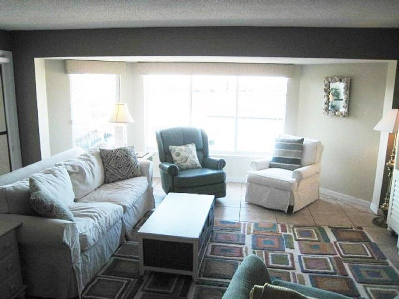 Living room with window to marina view