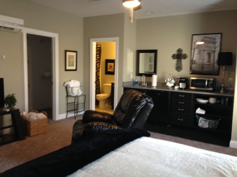 A comfortable queen bed; desk, bath, closet and kitchenette, cable hi-speed wifi