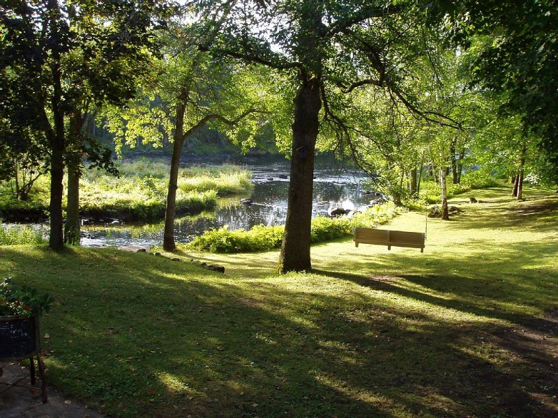 Take your morning coffee on the swing overlooking the Moira River