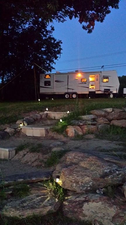 30' Camper is very neat, bright, and clean.  Outdoor terraces with bolder walls.
