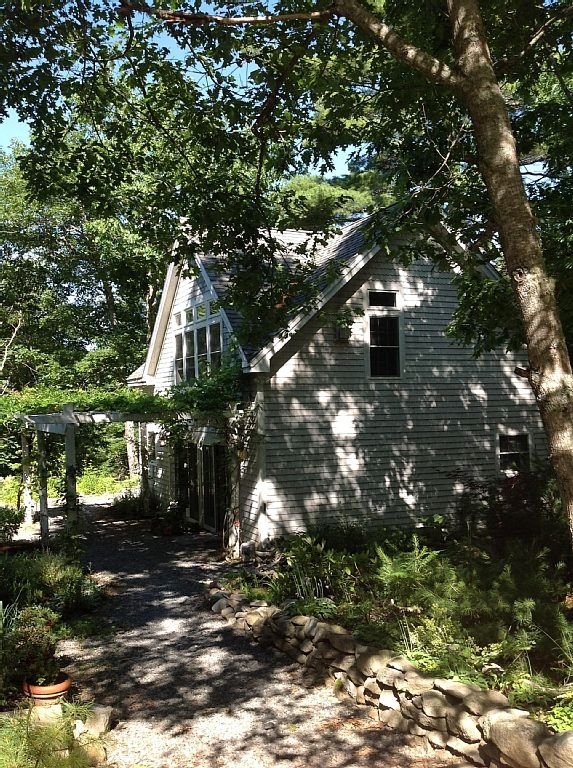 The carriage house greets you with it's lovely plantings and beautiful verandas.