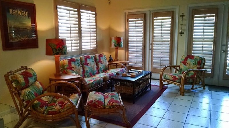 Relax here or on our patio outside with 2 beautiful palm trees!