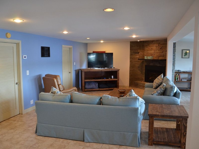 Fireplace and 55 inch TV highlight the huge family room