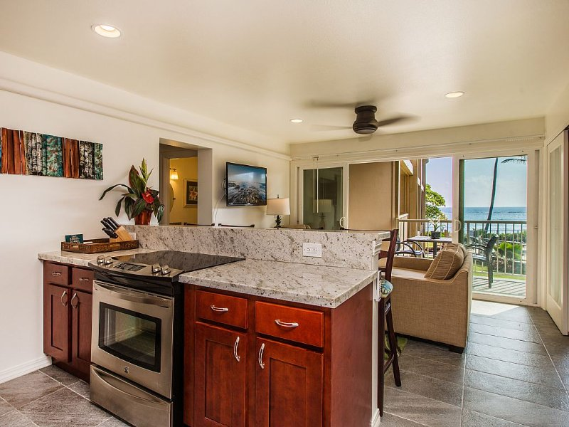 Full Kitchen with View of Living Room, Lanai and Ocean