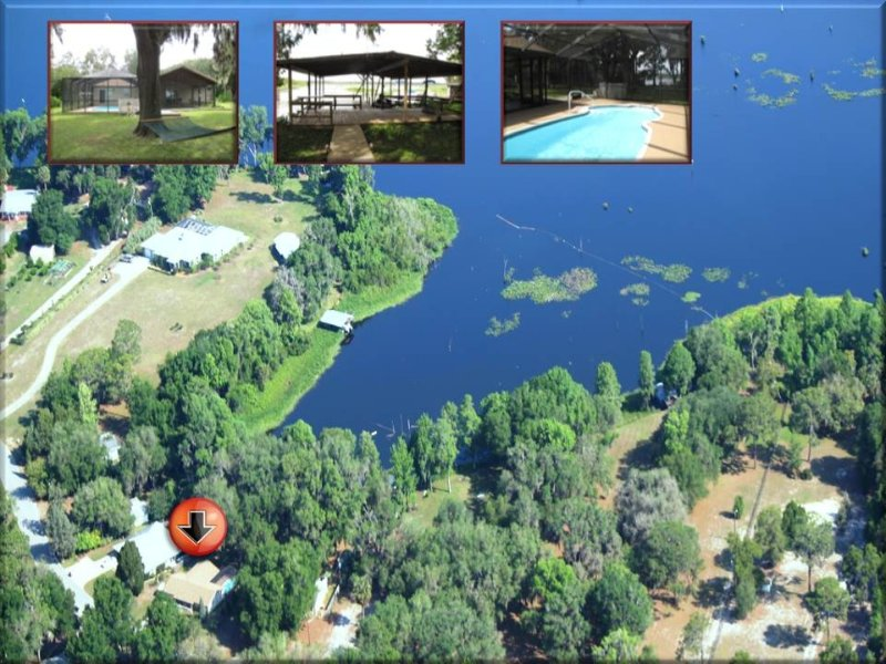 Lakefront Home! Heated Pool, Canoe, Kayaks, Boat House, Dock, Hammock, Fire Pit! – semesterbostad i Dunnellon