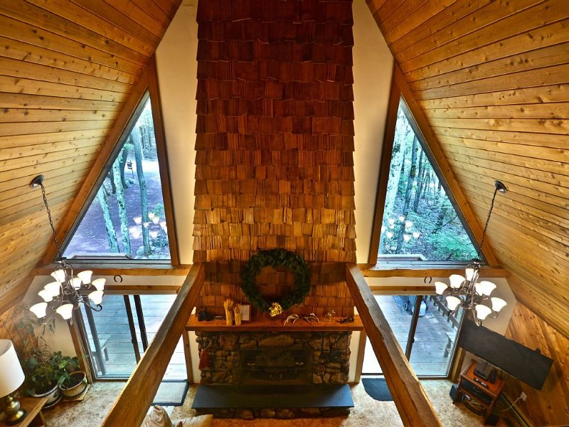 View of living room with gas fireplace from the master bedroom Juliette balcony.