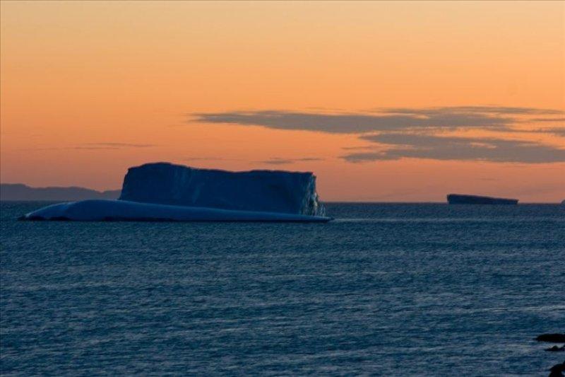 Iceberg in Sunset off Crow Head , Twillingate Island