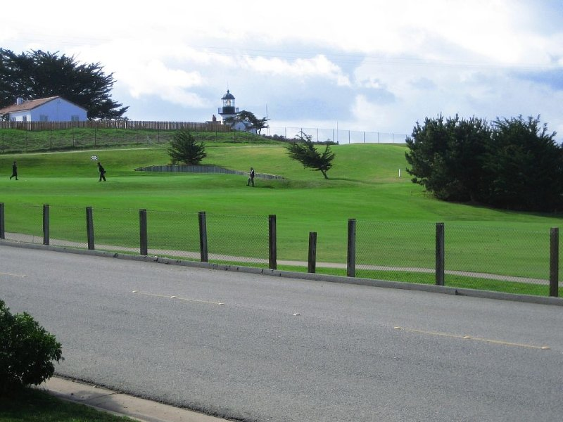 View from front patio toward 18th green. Pt Pinos Lighthouse in the background.