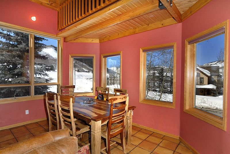 Bright dining area with gorgeous 270 degree views , including Mt Crested Butte.
